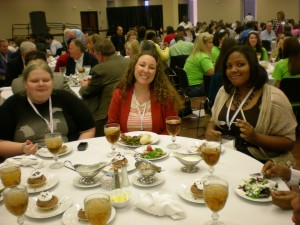 Third-year mentee Michelle Sisson (center) from Lee High School in Huntsville, Ala., celebrates with two of her students at the Alabama Scholastic Press Association's convention luncheon April 2012.