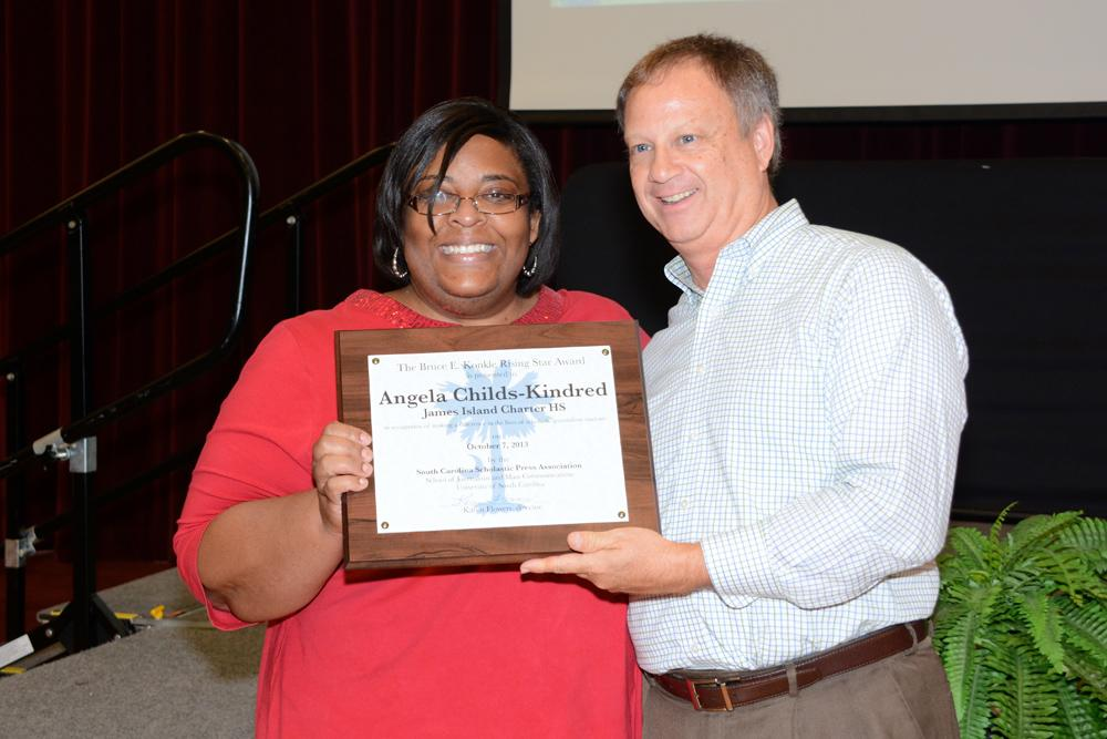 Photo by Lewis Zeigler, USC CMCIS. Angela Childs-Kindred receives SCSPA's 2013 Rising Star Award from Dr. Bruce E. Konkle. Konkle was director of SCSPA for 17 years.
