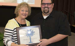 Former SCSPA director Karen Flowers presents AJ Chambers, Summerville HS broadcast adviser, with the 2015 Bruce E. Konkle Rising Star Award.
