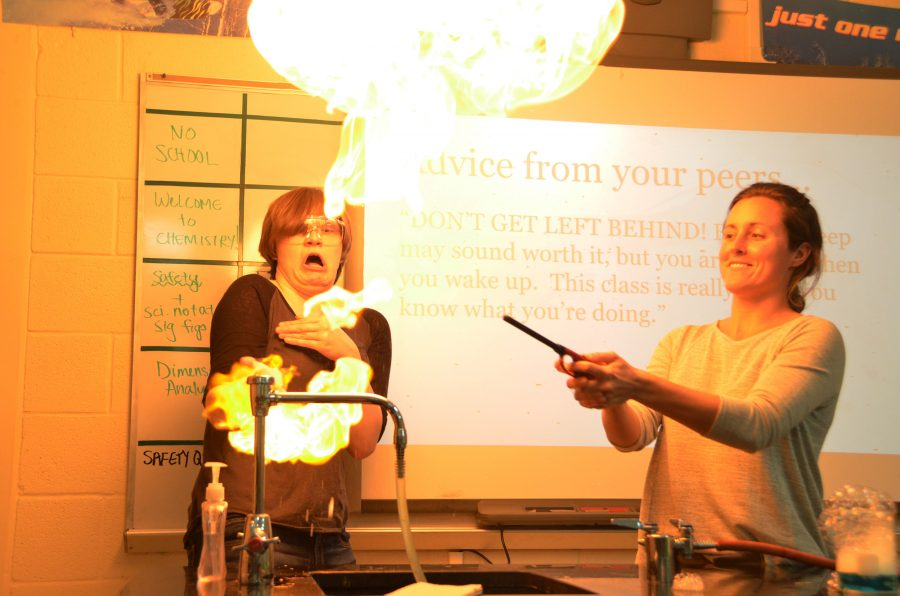 Science teacher Leah Rutkowski lights up the room during a chemistry lab.