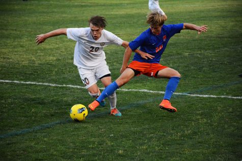 """Sam Ross, 12, beats his opponent with a powerful dribbling move on the ball. """"The team was ecstatic after we beat River Bluff in lower state,"""" Ross said."""