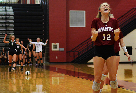 Junior Grae Gosnell and opponents react after she scored the match point to win.